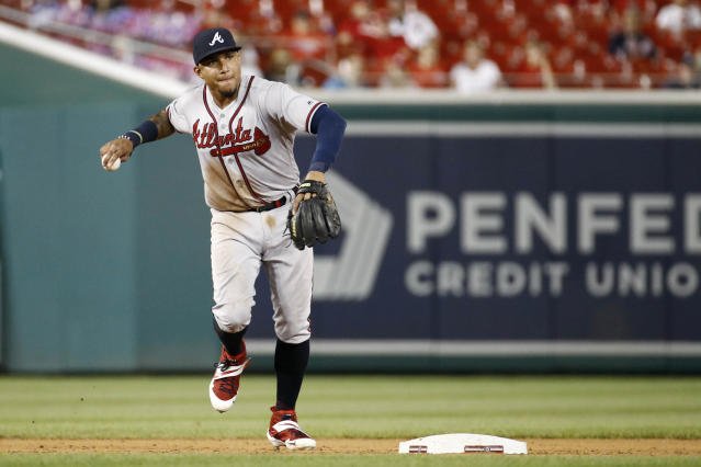 File-This July 30, 2019, file photo shows Atlanta Braves shortstop Johan Camargo throwing out Washington Nationals' Howie Kendrick at first base on his ground ball during the eighth inning of a baseball game in Washington. Camargo sees an open path to a second chance to be the Atlanta Braves' starting third baseman. After hard lessons in a demotion to the minors last season, Camargo has renewed motivation to make the most of this second opportunity. (AP Photo/Patrick Semansky, File)