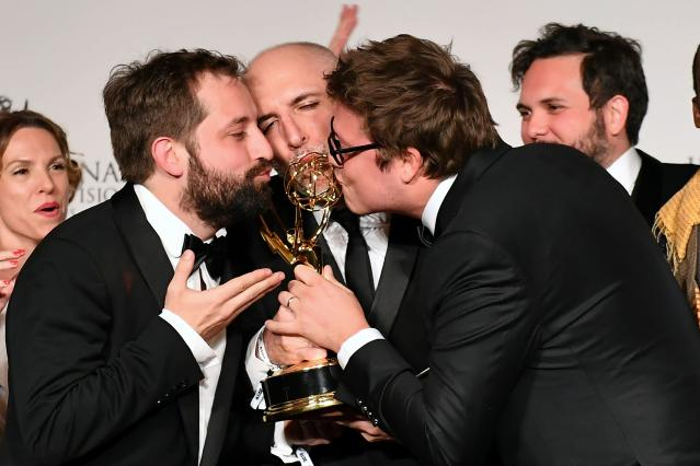 """Brazilian actor, writer, creator Fabio Porchat (R) poses in the press room with the award for """"Comedy"""" for """"Especial do Natal Porta dos Fundos 'The Last Hangover'"""" during the 47th Annual International Emmy Awards at New York Hilton on November 25, 2019 in New York City. - The International Emmy Award is an award ceremony bestowed by the International Academy of Television Arts and Sciences in recognition to the best television programs initially produced and aired outside the United States. (Photo by Angela Weiss / AFP) (Photo by ANGELA WEISS/AFP via Getty Images)"""