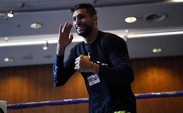 Britain's Amir Khan attends a pre-fight public work out at Paradise Place in Liverpool on April 17, 2018, ahead of his welterweight boxing bout against Canada's Phil Lo Greco set for April 21 (AFP Photo/Paul ELLIS)
