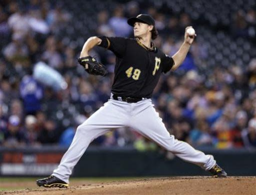 Pittsburgh Pirates starting pitcher Jeff Locke throws against the Seattle Mariners in the first inning of a baseball game Tuesday, June 25, 2013, in Seattle. (AP Photo/Elaine Thompson)