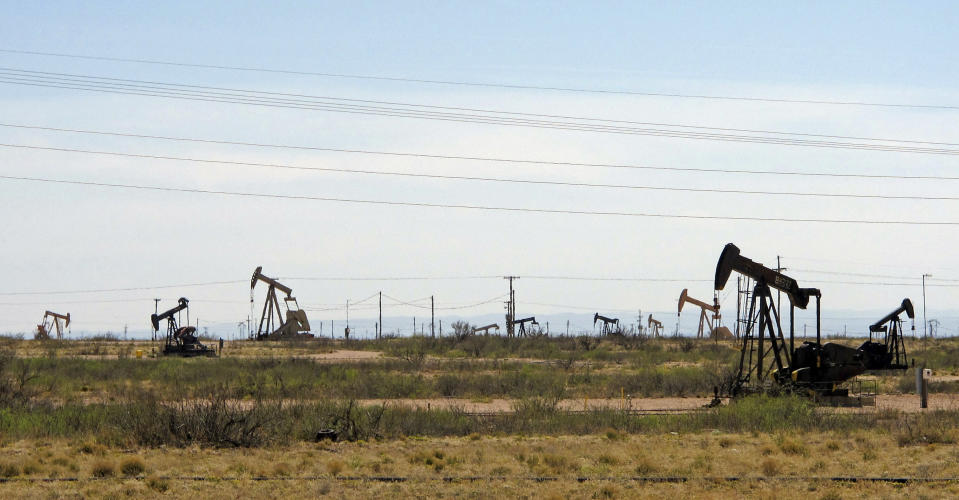 FILE - In this April 9, 2014, file photo, oil rigs stand in the Loco Hills field on U.S. Highway 82 in Eddy County near Artesia, N.M., one of the most active regions of the Permian Basin. President Joe Biden is set to announce a wide-ranging moratorium on new oil and gas leasing on U.S. lands, as his administration moves quickly to reverse Trump administration policies on energy and the environment and address climate change. (AP Photo/Jeri Clausing, File)