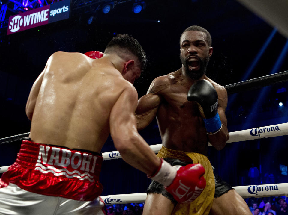 Gary Russell Jr., (R) battles Joseph Diaz Jr. during their WBC featherweight title fight in Oxon Hill, Md., Saturday, May 19, 2018. Russell won by unanimous decision. ( AP Photo/Jose Luis Magana)