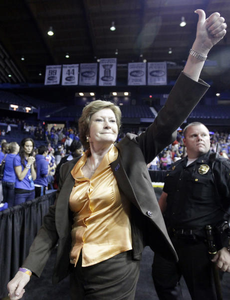 "FILE - In this March 19, 2012, file photo, Tennessee head coach Pat Summitt gives a thumbs-up as she leaves the court after Tennessee defeated DePaul 63-48 in an NCAA tournament second-round women's college basketball game in Rosemont, Ill. Summitt, the sport's winningest coach, is stepping aside as Tennessee's women's basketball coach and taking the title of ""head coach emeritus"", the university announced Wednesday, April 18, 2012. Long-time assistant Holly Warlick has been named as Summitt's successor.(AP Photo/Nam Y. Huh, File)"