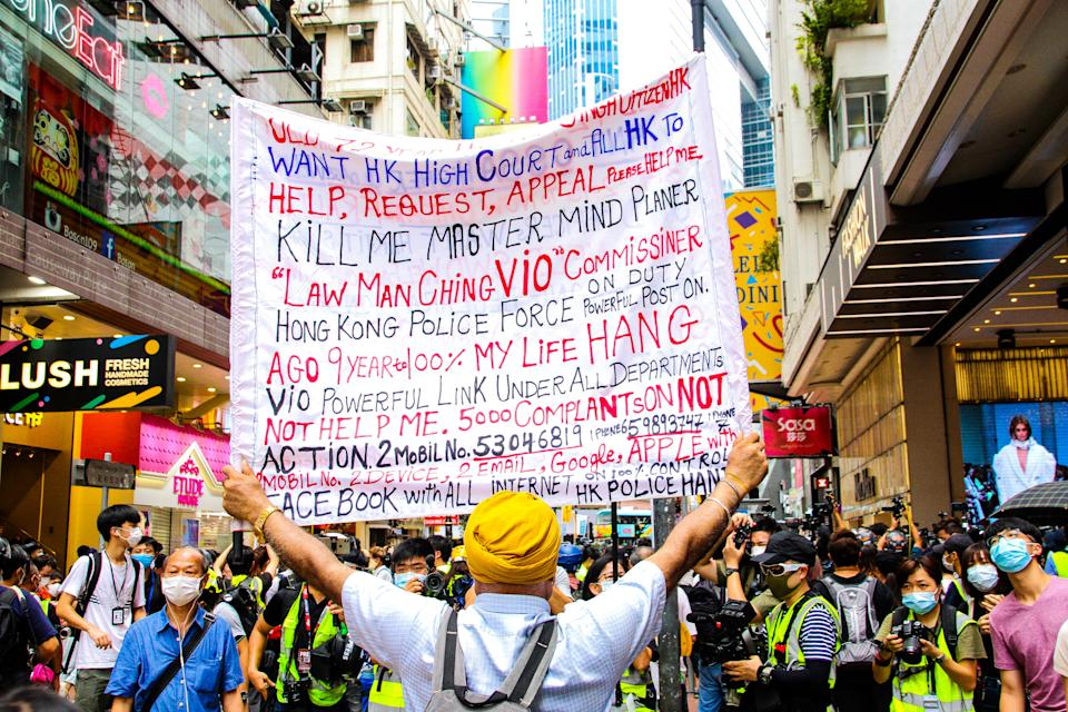 A protester holds a sign up during street protests against the national security law in Hong Kong, China on  July 1, 2020. (Photo by Tommy Walker/NurPhoto via Getty Images)