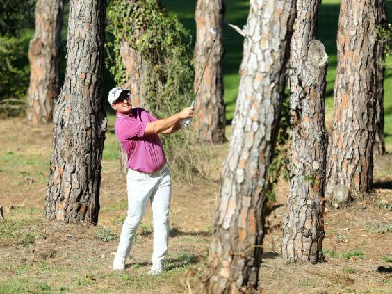Ryan Fox plays out of the trees in Antalya (Getty)