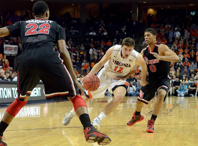Virginia's Joe Harris, center, drives to the hoop against St. John's Jamal Branch, right, and Amir Garrett during an NIT college basketball game in Charlottesville, VA., Sunday, March 24, 2013.   (AP Photo/Pat Jarrett)