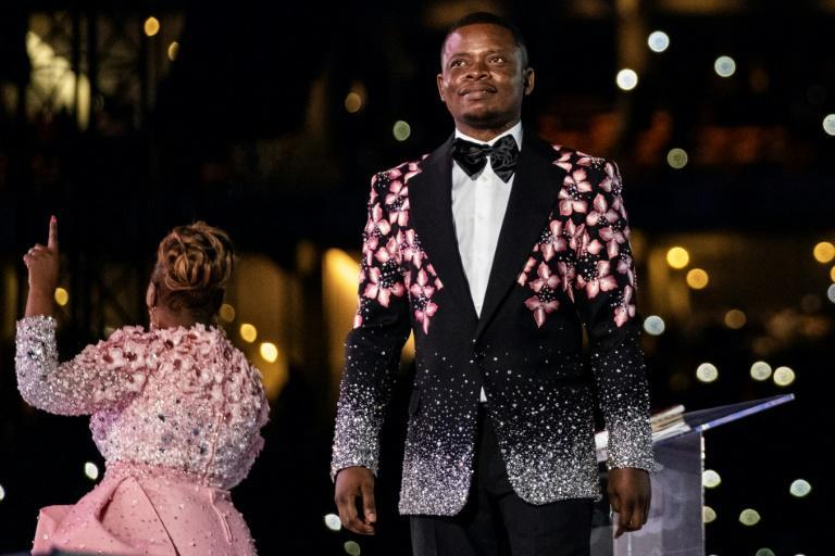 Arrested: Shepherd Bushiri, seen here on stage with his wife, Mary Bushiri, at a stadium in Soweto on New Year's Day