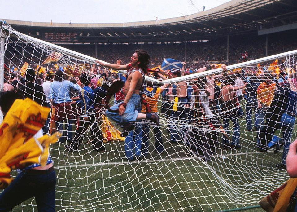 Scotland fans bring down the goalpost during the pitch invasion after the game at Wembley Scotland's victory ensured the won the championship for the second consecutive year - Colorsport/REX