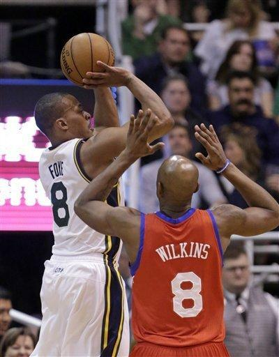 Utah Jazz's Randy Foye (8) shoots as Philadelphia 76ers' Damien Wilkins (8) defends in the second quarter during an NBA basketball game Monday, March 25, 2013, in Salt Lake City. (AP Photo/Rick Bowmer)