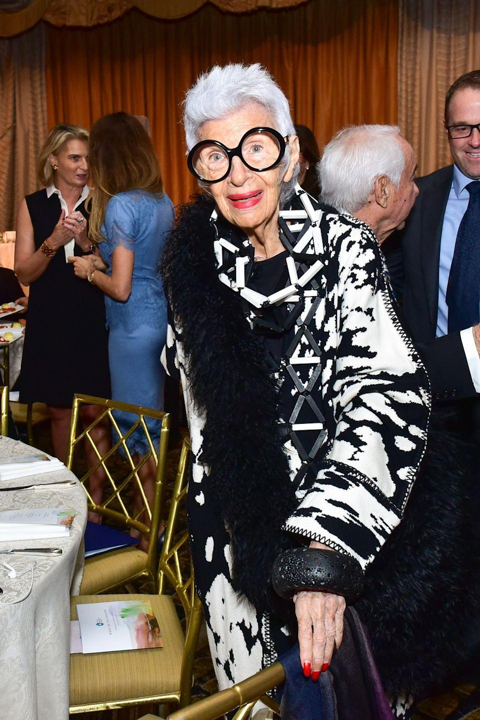 <p>A beautiful mottled black-and-white jacket and modular necklace are worn so well by Iris during a luncheon at The Pierre Hotel in New York City.<br></p>