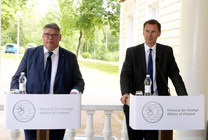 Finland's Minister for Foreign Affairs Timo Soini, left, holds a press conference with British Foreign Secretary Jeremy Hunt, in Vantaa, Finland, Tuesday, Aug. 14, 2018. (Vesa Moilanen/Lehtikuva via AP)