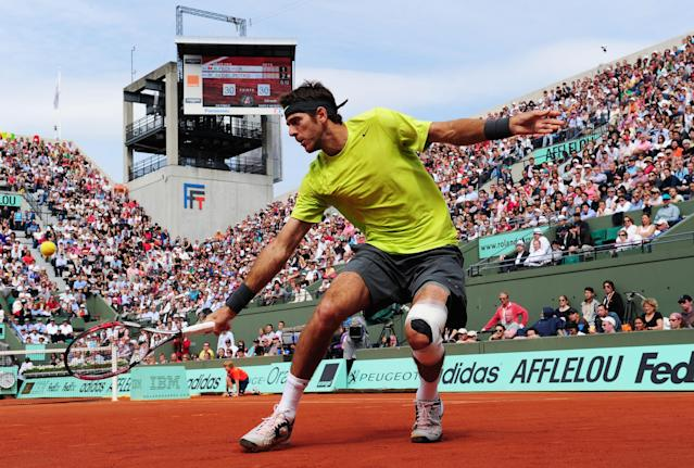 PARIS, FRANCE - JUNE 05: Juan Martin Del Potro of Argentina in action in his men's singles quarter final match against Roger Federer of Switzerland during day 10 of the French Open at Roland Garros on June 5, 2012 in Paris, France. (Photo by Mike Hewitt/Getty Images)