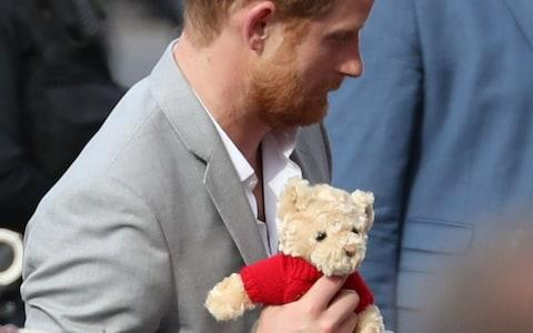 Prince Harry with a teddy bear he was given from an adoring audience member - Credit: Stephen Lock/I-Images