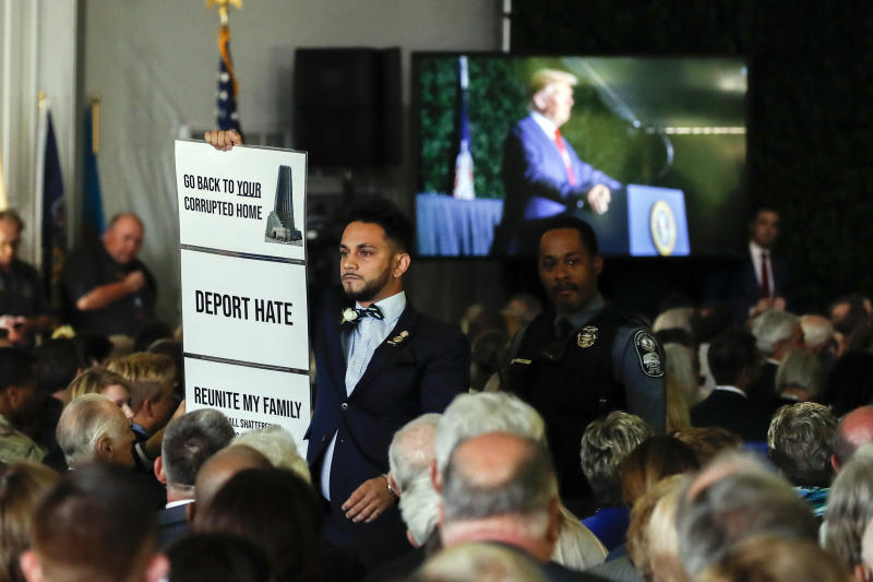 Virginia Del. Ibraheem Samirah, D-Fairfax, is escorted out after interrupting President Donald Trump as he spoke at an event marking the 400th anniversary of the first representative assembly, Tuesday, July 29, 2019, in Jamestown, Va. (AP Photo/Alex Brandon)