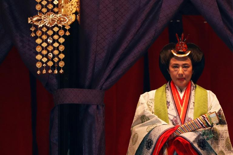 Empress Masako, a Harvard-educated former diplomat, remained silent during the ceremony