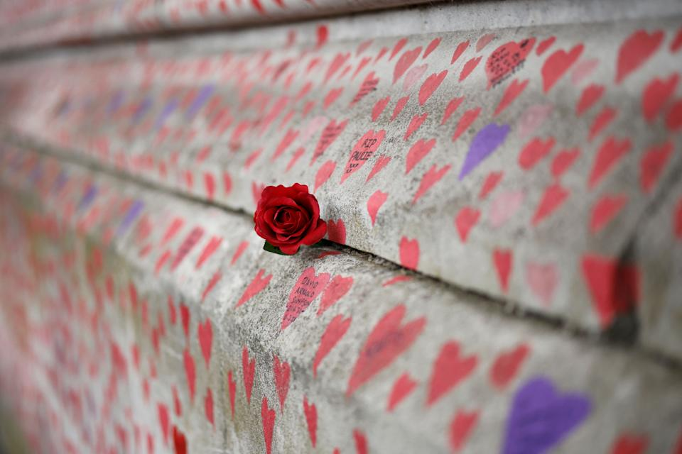 A red rose is attached to the National Covid Memorial Wall on the embankment on the south side of the River Thames in London (Photo: TOLGA AKMEN via Getty Images)