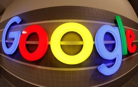An illuminated Google logo is seen inside an office building in Zurich Switzerland