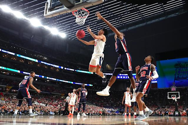 Kihei Clark #0 of the Virginia Cavaliers drives to the basket against Austin Wiley #50 of the Auburn Tigers in the first half during the 2019 NCAA Final Four semifinal at U.S. Bank Stadium on April 6, 2019 in Minneapolis, Minnesota. (Photo by Tom Pennington/Getty Images)