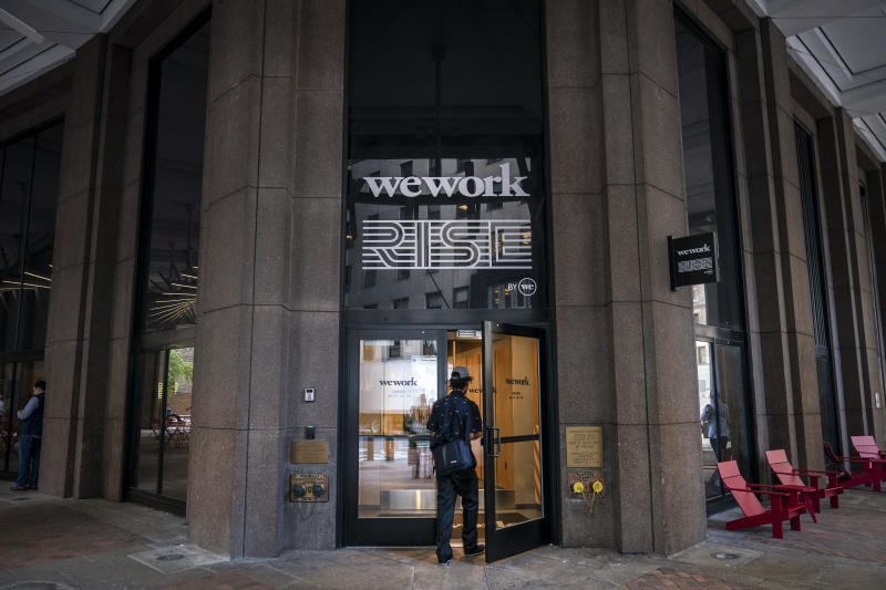 NEW YORK, NY - SEPTEMBER 13: A man enters a WeWork office facility stands in the Financial District in New York City on September 13, 2019. WeWork has chosen to list their IPO on the Nasdaq with a September 23 trading debut. The company is now considering a valuation of potentially less than $20 billion after being previously valued on the private market for as much as $47 billion. The company has also reduced CEO Adam Neumann's voting power after receiving sharp criticism of their corporate governance. (Photo by Drew Angerer/Getty Images)