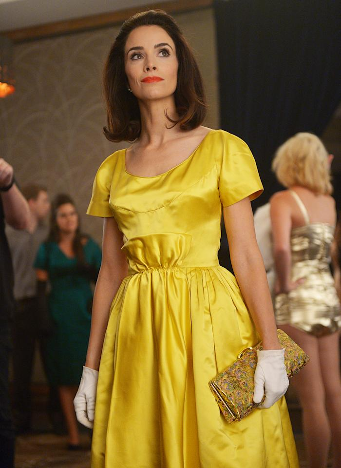 """<p>""""After the Lincoln [episode], we wanted the next time we see Lucy to be a 'pow!' moment. A lot of people can't wear that color, but we put her in canary yellow and a red lip and it worked. There aren't a lot of places in history we felt that we could do a canary yellow dress."""" (Photo by: Sergei Bachlakov/NBC) </p>"""