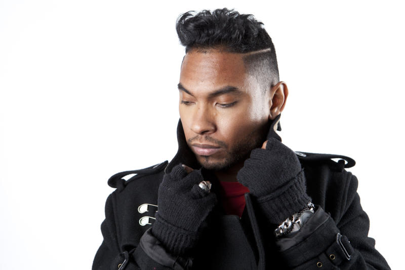 """In this Friday, Jan. 4, 2013 photo, American recording artist, songwriter and producer, Miguel, poses for a portrait, in New York. Miguel is nominated for five Grammy Awards, including song of the year for his No. 1 R&B hit, """"Adorn,"""" and best urban contemporary album for his sophomore release, """"Kaleidoscope Dream."""" The Grammys air Feb. 10., 2013. (Photo by Amy Sussman/Invision/AP Images)"""