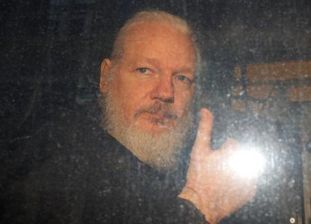 WikiLeaks founder Julian Assange is seen after was arrested by British police outside Westminster Magistrates Court in London, Britain April 11, 2019. REUTERS/Peter Nicholls