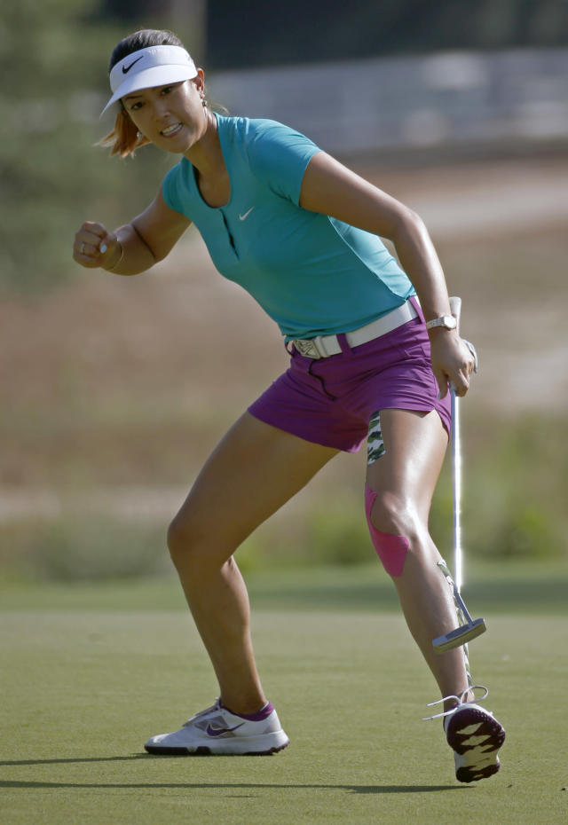 Michelle Wie reacts as she makes a birdie putt on the 17th hole en route to winning the U.S. Women's Open golf tournament in Pinehurst, N.C., Sunday, June 22, 2014. (AP Photo/John Bazemore)