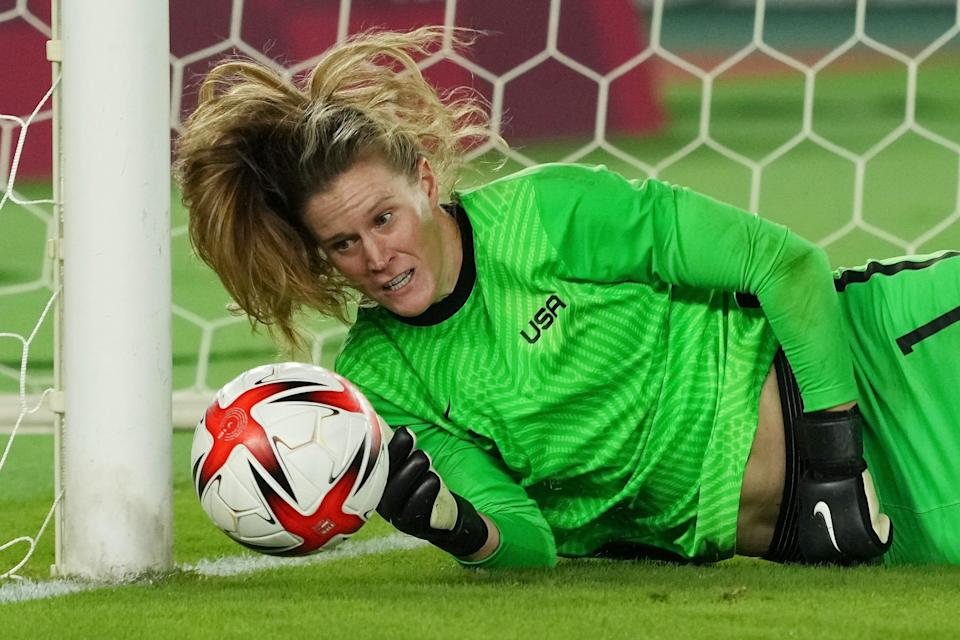 USWNT goalie Alyssa Naeher saves a shot against the Netherlands in a penalty shootout during the women's quarterfinals at the Tokyo Olympics.