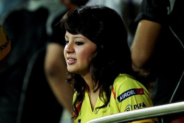 Sakshi watches the game. Her expression says it all.