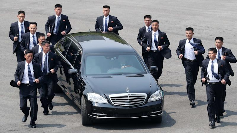 Kim Jong Un's Bevy Of Bodyguards Are Back — And Yes, They're Still Running
