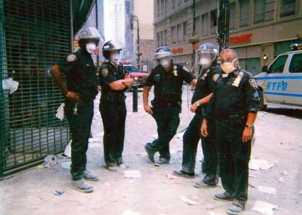 PHOTO: NYPD Sergeant Michael Guedes, far right, stands with a group of officers wearing face masks in Manhattan after the September 11 attack in 2001. (Courtesy Michael Guedes)
