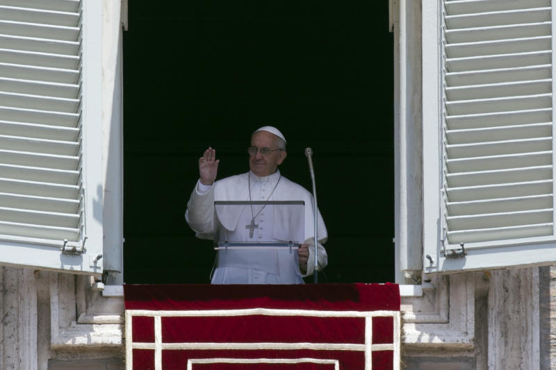 Pope Francis blesses the crowd during the Angelus noon prayer, from the window of his studio overlooking St. Peter's Square, at the Vatican, Sunday, June 2, 2013. (AP Photo/Andrew Medichini)