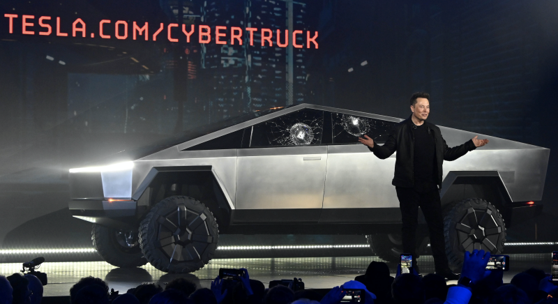 Tesla CEO Elon Musk unveils the Cybertruck at the TeslaDesign Studio in Hawthorne, Calif. The cracked window glass occurred during a demonstration on the strength of the glass. (Photo: Robert Hanashiro-USA TODAY)