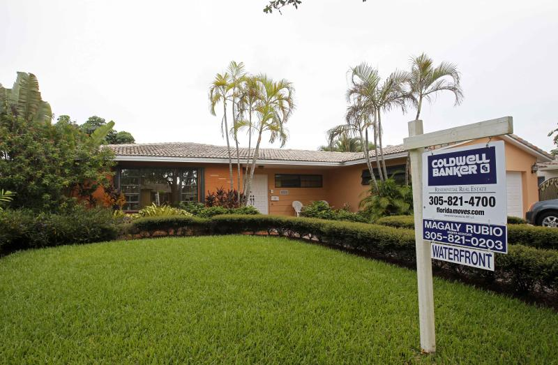 US rate on 30-year mortgage hits record 3.36 pct.