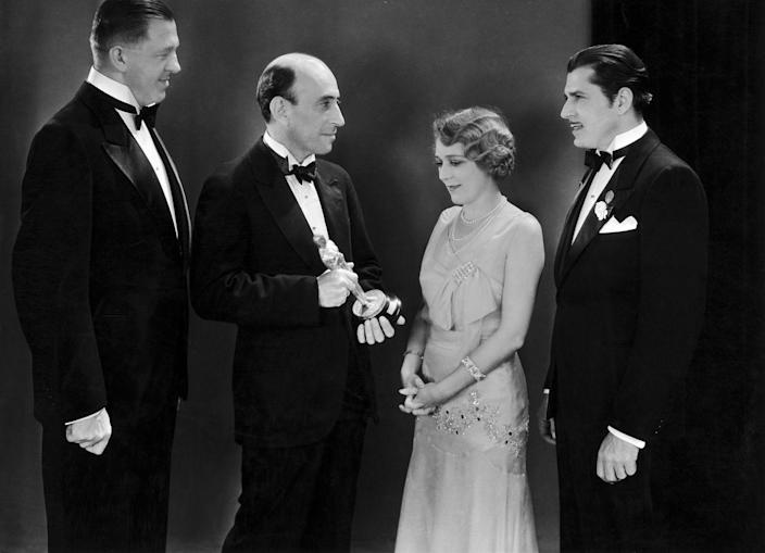 """<p>Old Hollywood is a time we'll never forget, and it shows how much Los Angeles has changed over the years. In this photo, you'll see William C. DeMille holding one of the first Oscars at the inaugural Academy Awards. Winners that year included Hanns Kraly, Mary Pickford, and Warner Baxter (all pictured here). </p><p><strong>RELATED: </strong><a href=""""https://www.goodhousekeeping.com/life/entertainment/g28117016/old-disney-movies/"""" rel=""""nofollow noopener"""" target=""""_blank"""" data-ylk=""""slk:The Disney Movie You Were Obsessed With in Kindergarten"""" class=""""link rapid-noclick-resp"""">The Disney Movie You Were Obsessed With in Kindergarten</a></p>"""
