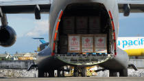 In this photo provided by the Presidential Communications Operations Office-Office of the Global Media Public Affairs, a Chinese military plane carrying the first batch of Sinovac vaccine from China arrives at the Villamor Air Base in Manila, Philippines on Sunday Feb. 28, 2021. The Philippines is due to receive its first batch of COVID-19 vaccine Sunday, among the last in Southeast Asia to secure the critical doses despite having the second-highest number of coronavirus infections and deaths in the hard-hit region. (PCOO-OGMPA via AP)