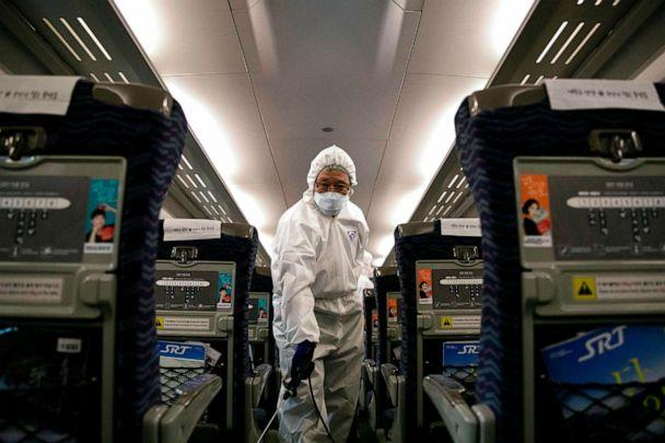PHOTO: A worker from a cleaning and disinfection service sprays disinfectant in a train as part of efforts to prevent the spread of a new virus which originated in the Chinese city of Wuhan at Suseo railway station in Seoul, South Korea, Jan. 24, 2020. (AFP via Getty Images)