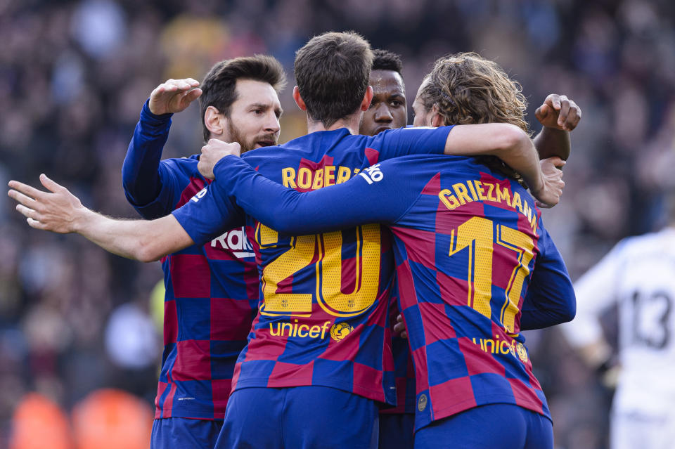 Lionel Messi (left) celebrates with Sergi Roberto, Ansu Fati and Antoine Griezmann after Griezmann's opening goal against Getafe. (Photo by Claudio Chaves/Eurasia Sport Images/Getty Images)