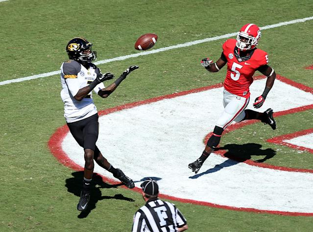 Missouri wide receiver L'Damian Washington (2) makes a 16-yard touchdown catch in front of Georgia cornerback Damian Swann (5) in the first half of of an NCAA college football game game at Sanford Stadium Saturday, Oct. 12, 2013. in Athens, Ga. (AP Photo/Atlanta Journal-Constitution, Jason Getz)