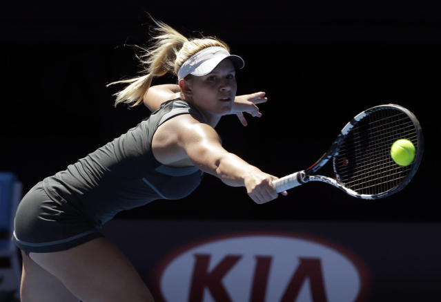 Jana Fett of Croatia makes a backhand return to Elizaveta Kulichkova of Russia in their girls' singles final at the Australian Open tennis championship in Melbourne, Australia, Saturday, Jan. 25, 2014. (AP Photo/Aijaz Rahi)