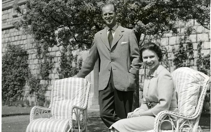 The Queen and Prince Philip on the lawn below the East Terrace in 1959 - The Times ROTA