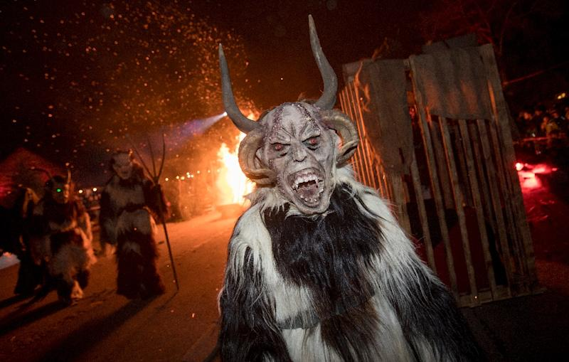 """Krampus"" is traditionally the evil sidekick of Santa, sent to frighten away ""evil spirits"" in the run-up to Christmas (AFP Photo/ALEX HALADA)"