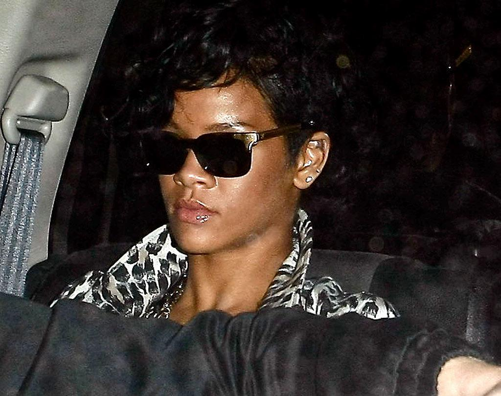 "A sunglasses-wearing Rihanna attended a belated 21st birthday bash at Coco de Ville on Tuesday. Her real birthday was February 20, twelve days after she was allegedly assaulted by Chris Brown. KMM/<a href=""http://www.x17online.com"" target=""new"">X17 Online</a> - March 10, 2009"