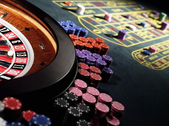 Photo of a roulette table at a casino.