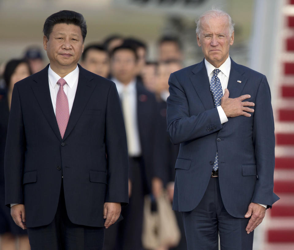 FILE - In this Sept. 24, 2015, file photo, Chinese President Xi Jinping, Vice President Joe Biden, stand for the U.S. national anthem during an arrival ceremony in Andrews Air Force Base, Md. (AP Photo/Carolyn Kaster, File)