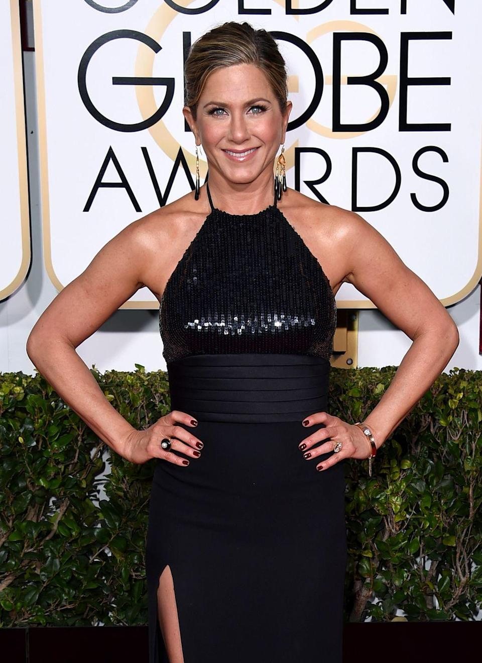 <p>It's clear Jen's go-to color is black, and it's easy to see why. She looks <em>fabulous</em>. She wore this shimmery dress to the Golden Globe Awards in 2015, where she was nominated for her role in <em>Cake</em>. <br></p>