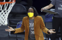 California head coach Charmin Smith talks with an official during an NCAA college basketball game in the first round of the Pac-12 women's tournament Wednesday, March 3, 2021, in Las Vegas. (AP Photo/Isaac Brekken)