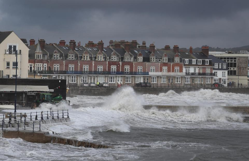 Waves crash along the coast at Swanage in Dorset. Parts of the UK are preparing to be lashed by heavy rain and high winds as Storm Alex heralds the arrival of a stretch of bad weather over the weekend.