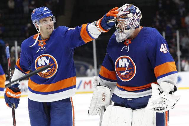 New York Islanders center Derick Brassard (10) celebrates with goaltender Semyon Varlamov (40) after the Islanders defeated the Florida Panthers 3-2, following the shootout in an NHL hockey game Saturday, Oct. 12, 2019, in Uniondale, N.Y. (AP Photo/Kathy Willens)