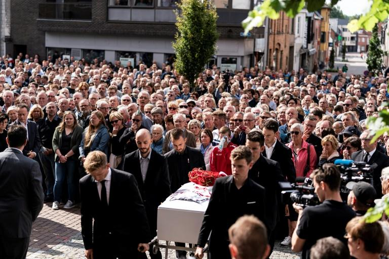 Teammates of Belgian cyclist Bjorg Lambrecht carry his coffin prior to his funeral ceremony in Knesselare